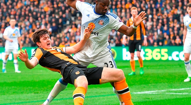 Hull City's Harry Maguire goes to ground in the penalty area after a challenge by Sunderland's Lamine Kone. Photo: PA News