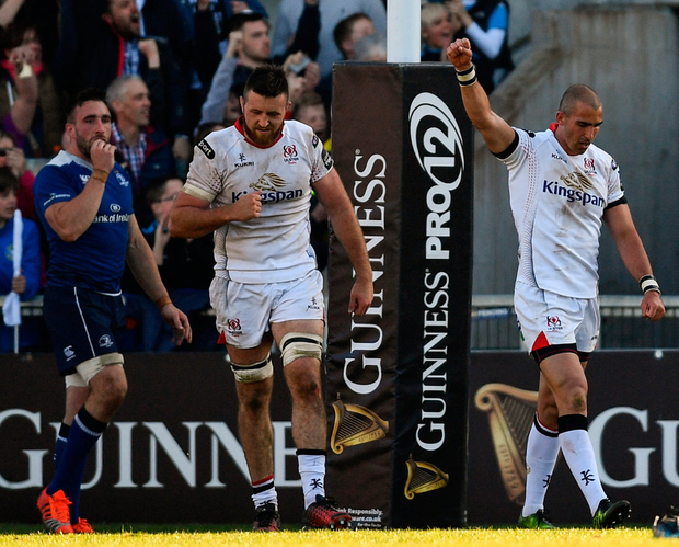 Ruan Pienaar (right) celebrates setting up his side's second try by Andrew Trimble during the match between Ulster and Leinster in Belfast. Photo: Sportsfile