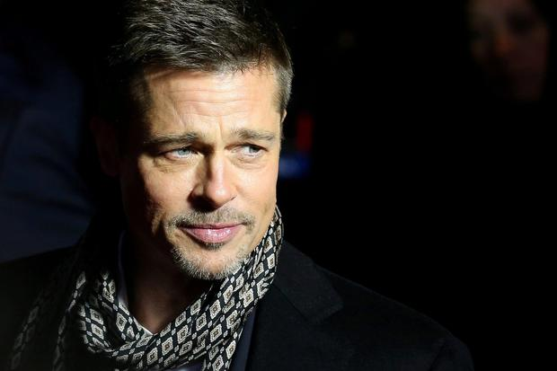 GOOD, BRAD AND THE BUBBLY: Brad Pitt Picture: Reuters