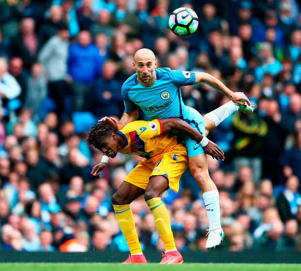 Pablo Zabaleta of Manchester City (right) clashes with Crystal Palace's Wilfried Zaha during the Premier League match at the Etihad Stadium yesterday. Photo: Dave Thompson