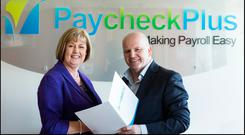 PaycheckPlus founder Anne Reilly with Sean Gallagher at the firm's Drogheda HQ. Photo: David Conachy