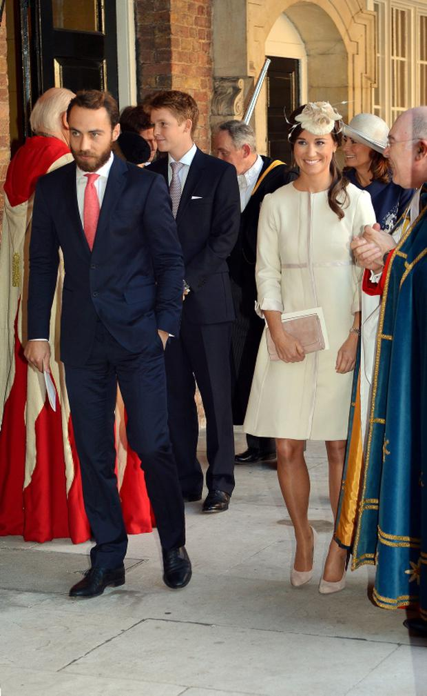 Hugh (pictured behind Pippa and James Middleton) at Prince George's christening in 2013