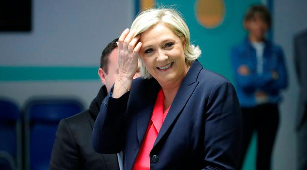 Marine Le Pen, French National Front (FN) political party candidate for French 2017 presidential election, smiles before voting in Henin-Beaumont, France, May 7, 2017. REUTERS/Charles Platiau