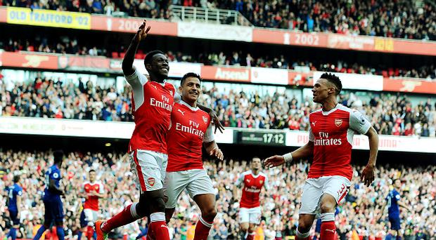 LONDON, ENGLAND - MAY 07: (L) Danny Welbeck celebrates scoring the 2nd Arsenal goal with (2ndR) Alexis Sanchez and (R) Kieran Gibbs during the Premier League match between Arsenal and Manchester United at Emirates Stadium on May 7, 2017 in London, England. (Photo by Stuart MacFarlane/Arsenal FC via Getty Images)