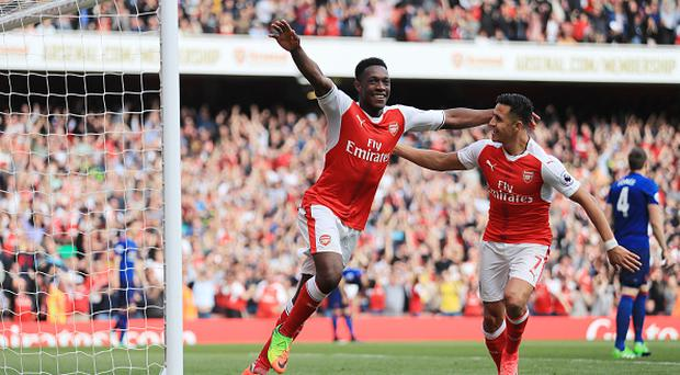 Danny Welbeck of Arsenal celebrates scoring his sides second goal with Alexis Sanchez of Arsenal during the Premier League match between Arsenal and Manchester United at the Emirates Stadium. (Photo by Richard Heathcote/Getty Images)