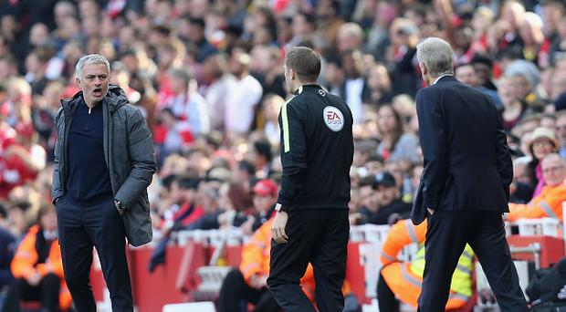 Manager Jose Mourinho of Manchester United and Manager Arsene Wenger of Arsenal speak to the fourth official during the Premier League match between Manchester United and Arsenal at Emirates Stadium on May 7, 2017 in London, England. (Photo by John Peters/Man Utd via Getty Images)