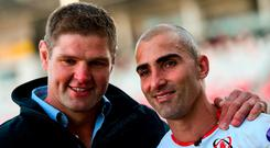 A tearful Ruan Pienaar alongside former Ulster captain Johann Muller after his farewell competitive appearance for Ulster at Kingspan Stadium. Photo: Ramsey Cardy/Sportsfile