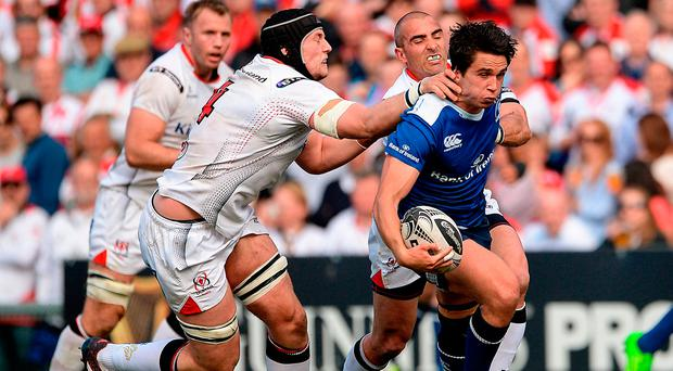 Joey Carbery is tackled by Kieran Treadwell and Ruan Pienaar. Photo by Oliver McVeigh/Sportsfile