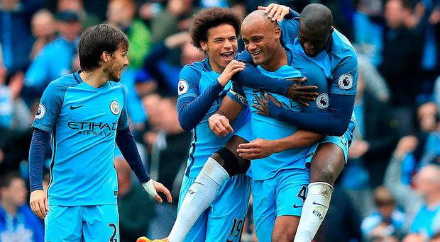 Vincent Kompany is congratulated after scoring for Manchester City in their win over Crystal Palace. Photo: Mike Egerton/PA Wire.