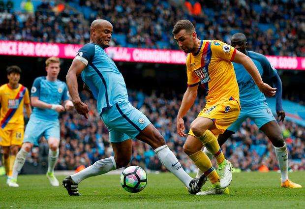 Manchester City's Vincent Kompany in action with Crystal Palace's James McArthur. Photo: Andrew Yates/Reuters