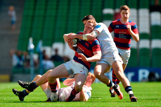 Rob Keogh of Clontarf is tackled by Shane Daly and Robert Jermyn of Cork Constitution. Photo by Matt Browne/Sportsfile