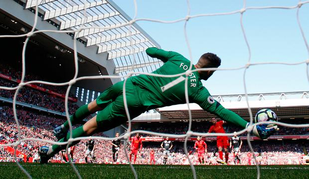 Liverpool's James Milner has his penalty saved by Fraser Forster. Photo: REUTERS