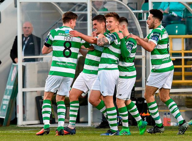 Dave McAllister is congratulated by his Shamrock Rovers team-mates after scoring in Friday's win over Dundalk. Photo: SPORTSFILE