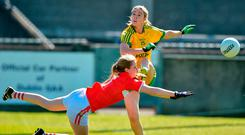 Cork's Roisin Phelan blocks down Yvonne McMonagle of Donegal in Parnell Park. Photo by David Maher/Sportsfile