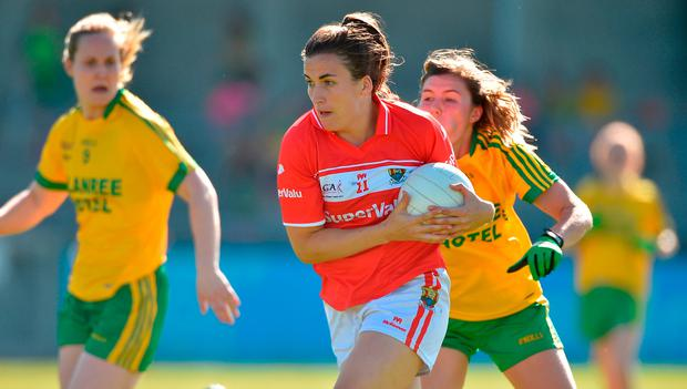 Brid O'Sullivan of Cork in action against Ciara Hegarty of Donegal. Photo by David Maher/Sportsfile