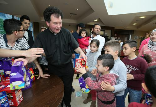 Ballaghaderreen curate Fr Joseph Gavigan gives Easter eggs to Syrian children at Abbeyfields Hotel Photo: Frank McGrath