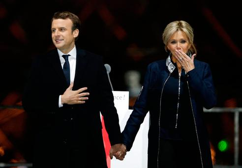 French President-elect Emmanuel Macron holds hands with his wife Brigitte during a victory celebration outside the Louvre museum in Paris, France (AP Photo/Thibault Camus)