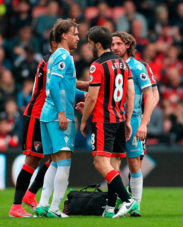 AFC Bournemouth's Harry Arter (8) and Stoke City's Joe Allen (right) clash after a heavy challenge during the Premier League match at the Vitality Stadium on Saturday