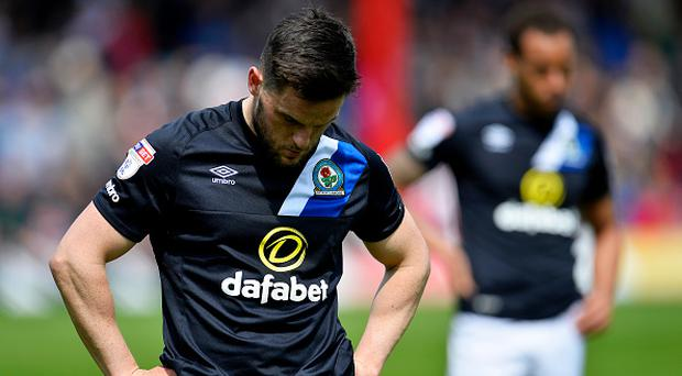 Craig Conway of Blackburn Rovers looks dejected after being relegated after the Sky Bet Championship match between Brentford and Blackburn Rovers at Griffin Park on May 7, 2017 in Brentford, England. (Photo by Justin Setterfield/Getty Images)