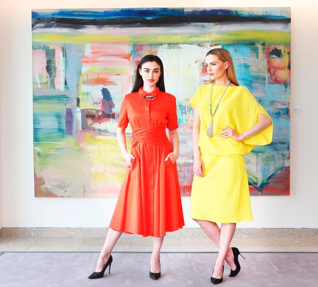Sarah Tansey and Sarah Morrissey wearing designs by designer Róisín Linnane. Photo: Leon Farrell/Photocall Ireland