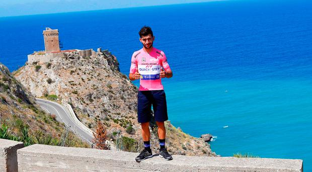 Race leader of the Giro, Fernando Gaviria of Quick-Step Floors, poses in the pink jersey at Altavilla Milicia during yesterday's rest day. Photo: Getty Images