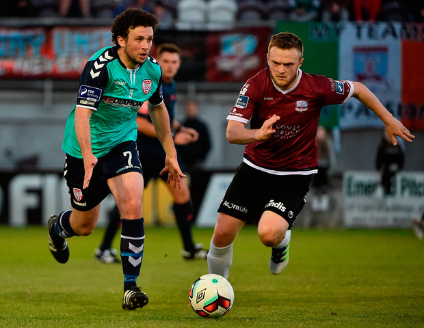 Barry McNamee of Derry City competes against David Cawley for possession. Photo: Sportsfile