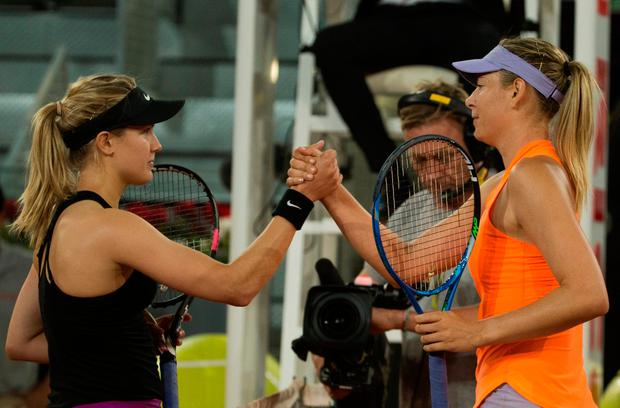 The pair shake hands after their second round clash in the Madrid Open. Photo: Reuters/Sergio Perez