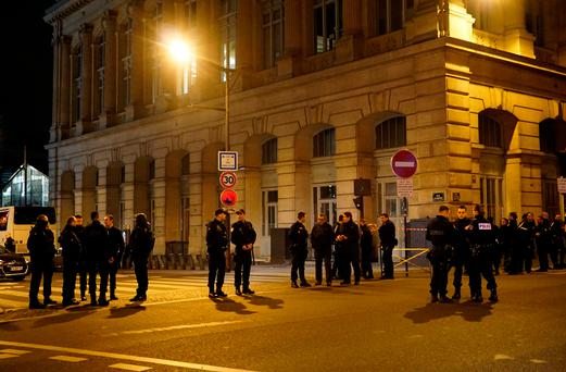 Police stand guard outside Paris' Gare du Nord station early Tuesday, May 9, 2017, following a security incident. (AP Photo/Raphael Satter)