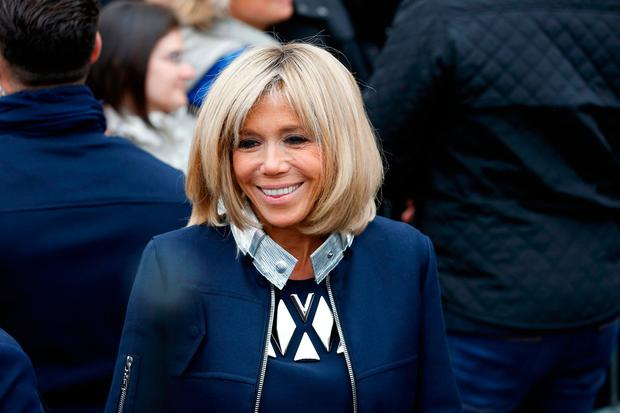 Wife of Emmanuel Macron, Brigitte Trogneux leaves the polling station of the the town hall after casting their vote in the second round of the French presidential elections on May 07 2017