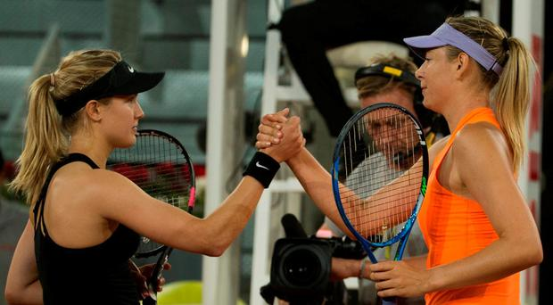 Eugenie Bouchard (L) shakes hands with Maria Sharapova after theie epic match.
