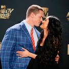 John Cena and Nikki Bella. REUTERS/Danny Moloshok