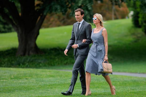 White House senior adviser Ivanka Trump and her husband senior adviser Jared Kushner walk along the South Lawn of the White House in Washington, U.S., as they accompanied U.S. President Donald Trump before his departure to New York May 4, 2017. REUTERS/Carlos Barria