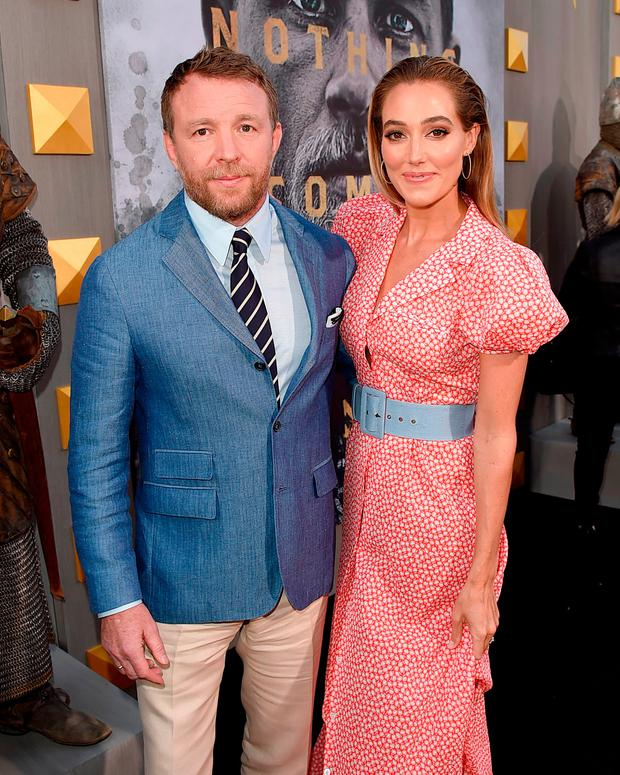 Director Guy Ritchie (L) and model Jacqui Ainsley attend the premiere of Warner Bros. Pictures'