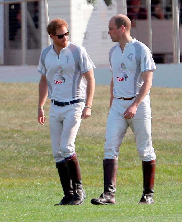 Prince Harry (left) and the Duke of Cambridge take part in the annual Audi Polo Challenge at Coworth Park polo club in Ascot, Berkshire