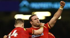 Jamie Roberts of Wales celebrates as he scores their third try with George North during the Six Nations match between Wales and Ireland at the Principality Stadium on March 10, 2017 in Cardiff, Wales. (Photo by Michael Steele/Getty Images)