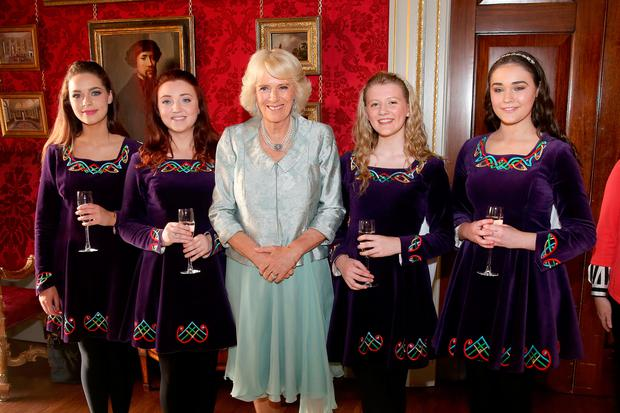 The Duchess of Cornwall (centre) meets the Tir na N-Og Irish Dancers, (left-right) Sarah White, Rose McAuley, Zoe McGarry, and Naomi Brown during a Music & Words for a Spring Evening at Hillsborough Castle during their visit to Northern Ireland (Liam McBurney/PA Wire)