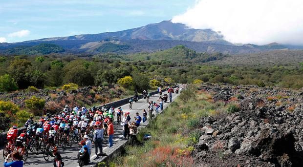 Riders climb towards the volcano of Mount Etna during yesterday's Giro d'Italia stage from Cefalu to Etna in Sicily. Photo: AFP/Getty Images