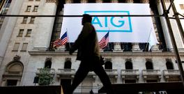A banner for American International Group Inc (AIG) hangs on the facade of the New York Stock Exchange, in New York