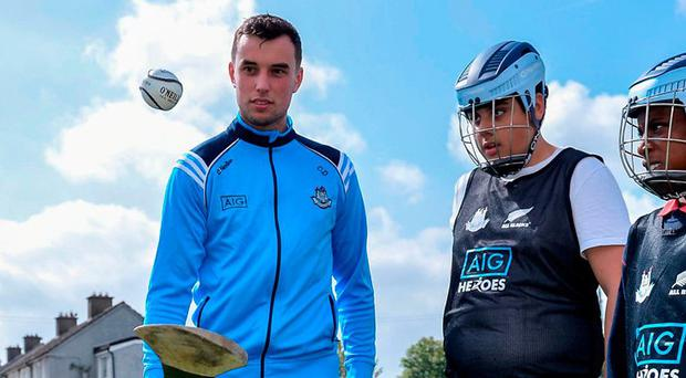 Dublin hurler Conor Dooley was in Bluebell CC yesterday at the AIG Heroes event along with pupils from St Ultan's School in Cherry Orchard. Photo: Sam Barnes/Sportsfile