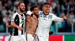 Juventus' Gonzalo Higuain, Dani Alves and Paulo Dybala celebrate at the end of the game. Photo: AP