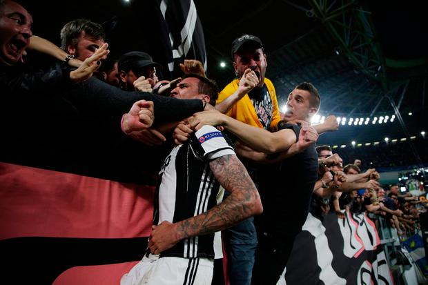 Mario Mandzukic celebrates with fans after putting Juventus into the lead. Photo: Reuters