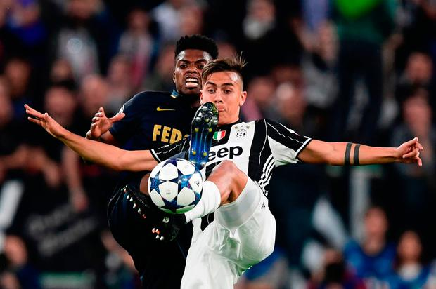 Juventus forward Paulo Dybala fights for the ball with Monaco defender Jemerson during the Champions League semi-final second leg last night. Photo: GETTY