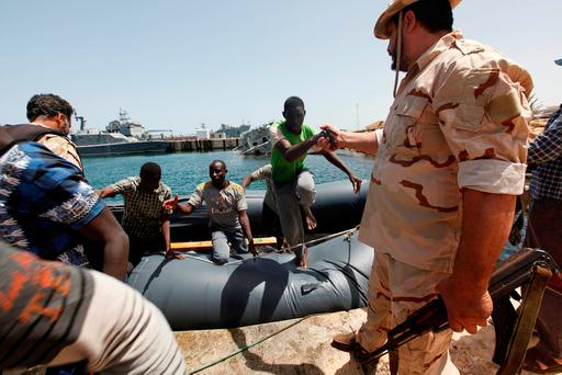 Illegal migrants arrive at a naval base after they were rescued by Libyan coastguard in the coastal city of Tripoli, Libya