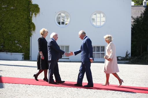 President Michael D Higgins and his wife Sabina greet Prince Charles and Camilla