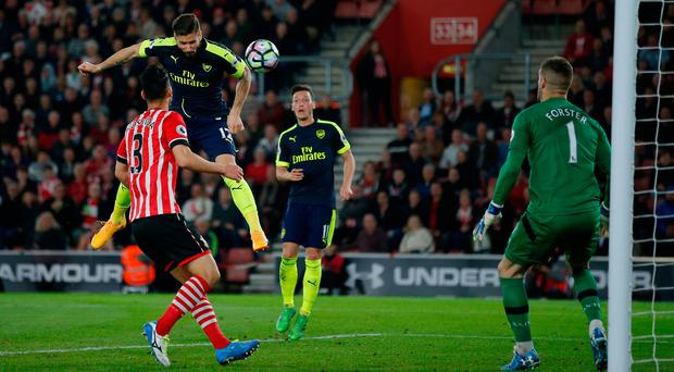 Arsenal's Olivier Giroud heads in his sides second goal. Photo: Reuters