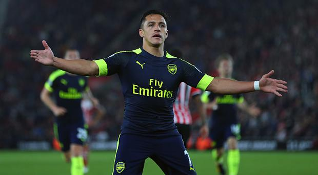 SOUTHAMPTON, ENGLAND - MAY 10: Alexis Sanchez of Arsenal celebrates after scoring to make it 0-1 during the Premier League match between Southampton and Arsenal at St Mary's Stadium on May 10, 2017 in Southampton, England. (Photo by Catherine Ivill - AMA/Getty Images)