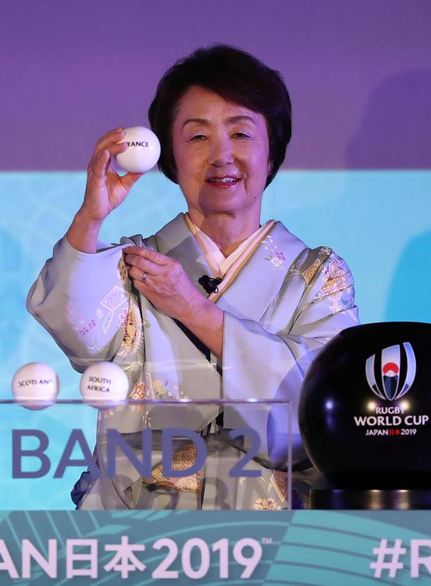 Fumiko Hayashi, the mayor of Yokohama city, picks out France in the draw in Japan yesterday. Photo: Reuters