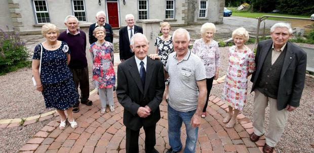 From left to right: Kathleen (75), Seamus (80), Terry (81), Rose (85), Tony (83), Sean (93), Mairead (86), Leo (72), Eileen (90), Maureen (92) and Peter (87) with BBC documentary maker Paul Muldoon. Photo: BBC