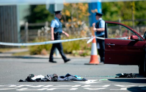 The scene of gun attack on James 'Mago' Gately showing his damaged car and bullet-proof vest on the ground