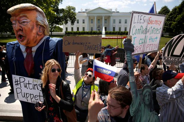 Protesters rally against US President Donald Trump's firing of FBI director James Comey, outside the White House in Washington yesterday. Photo: Jonathan Ernst
